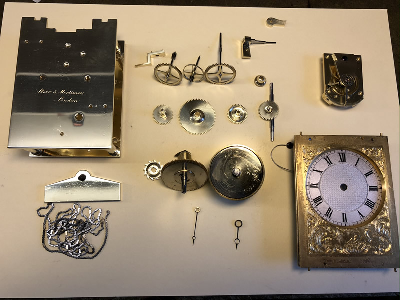 Storr & Mortimer carriage clock after cleaning laid out